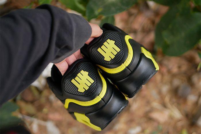 Undefeated Nike Air Max 90 Black Optic Yellow Leak Cj7197 001 Release Date Hand Heels
