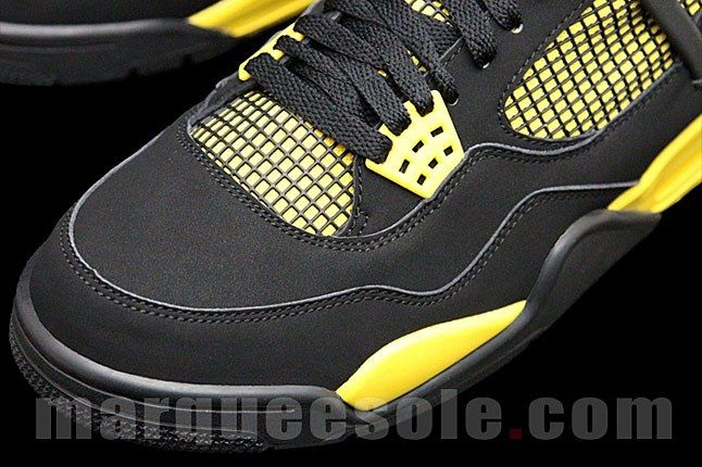 Jordan 4 Black Tour Yellow 1