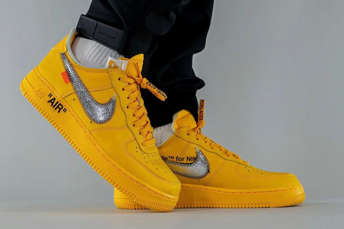 off white air force 1 university gold on foot