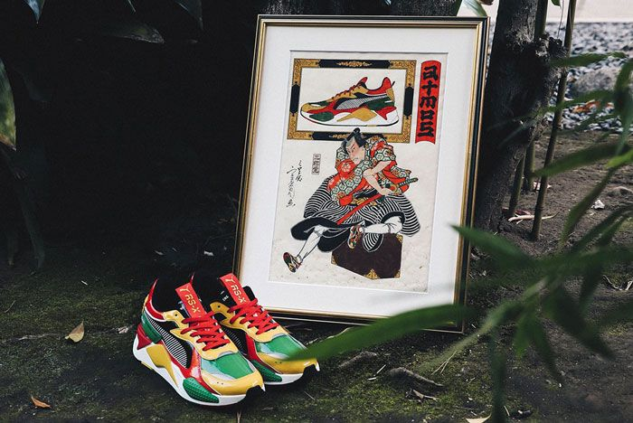 Atmos Puma Rs X Yellow Red Green Three Quarter Angle Background Shot