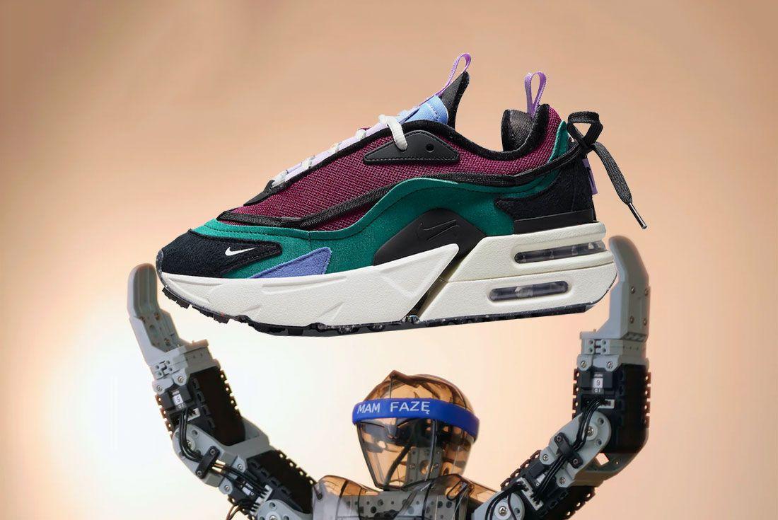 Robot Holding Nike Sneaker