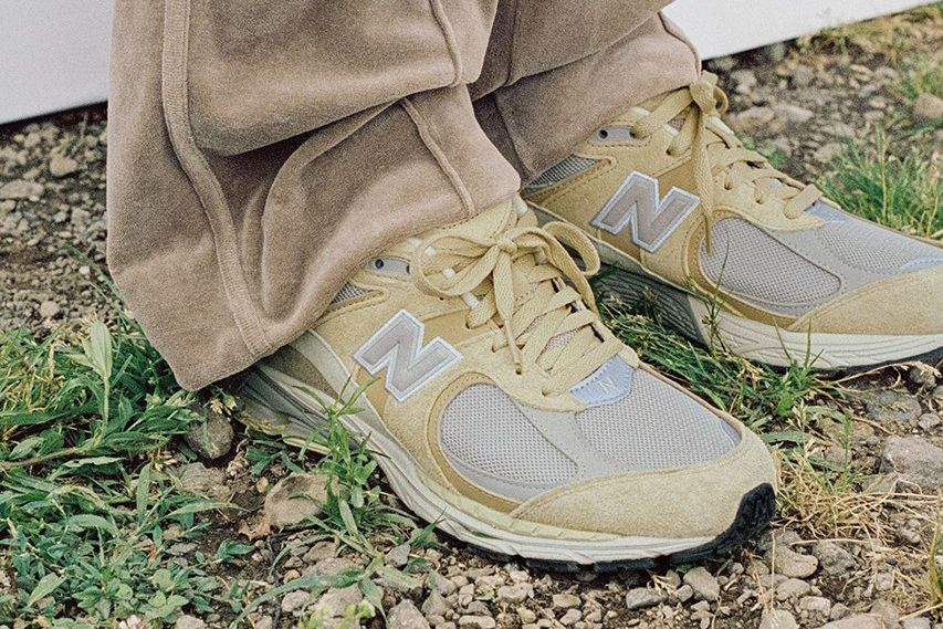 AURALEE x New Balance 2002R in tan and grey