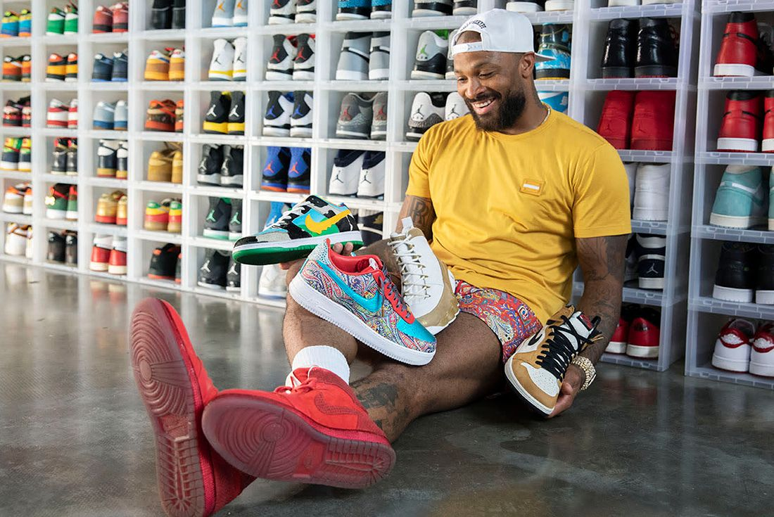 pj tucker sitting with sneakers