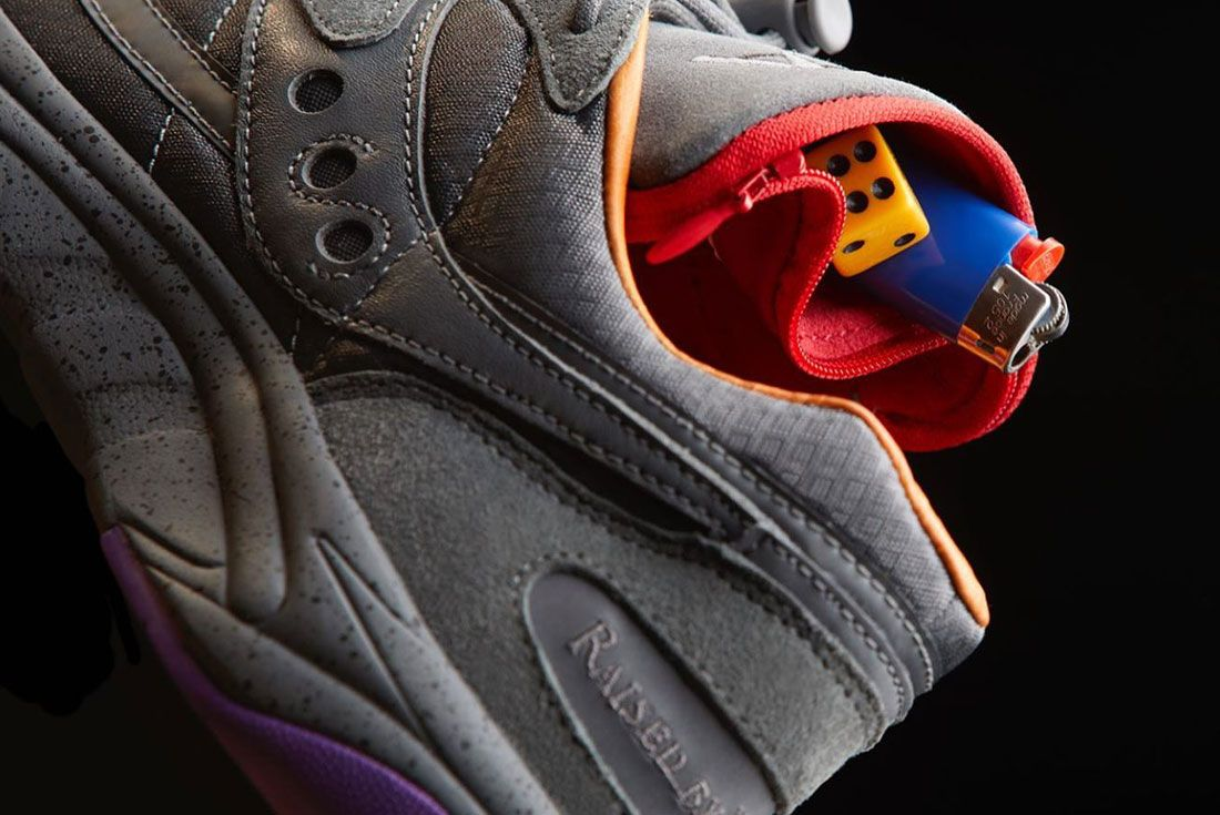 Saucony Raised By Wolves Ayay Grey Close Up Stash Pocket Shot