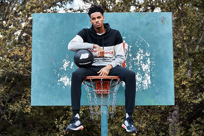 Dejounte Murray Joins New Balance Sitting On Hoop
