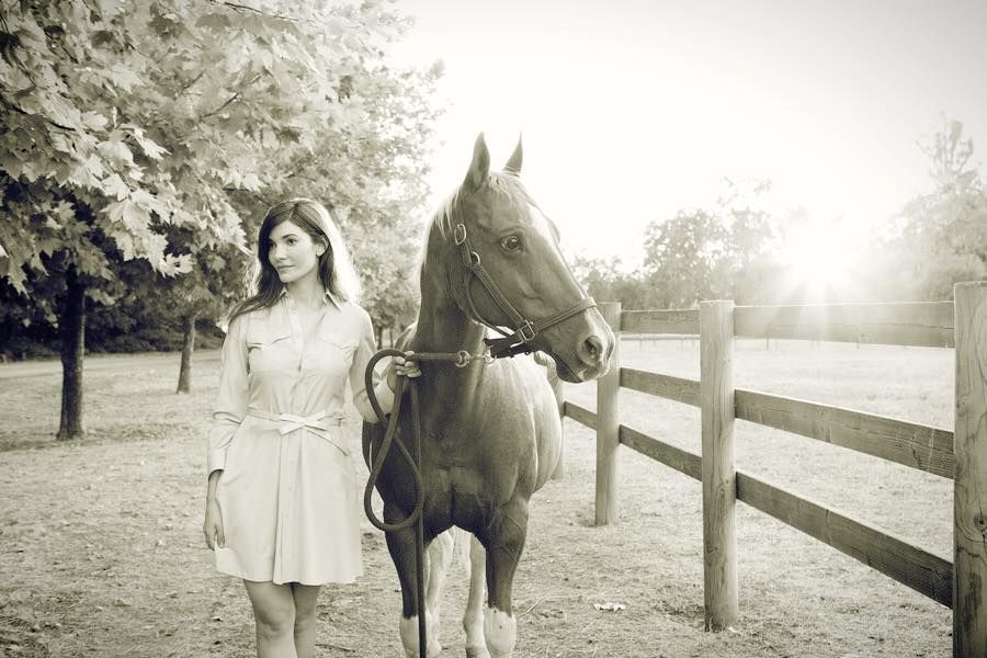 black and white photo of Julia Jackson with her horse in the sunshine