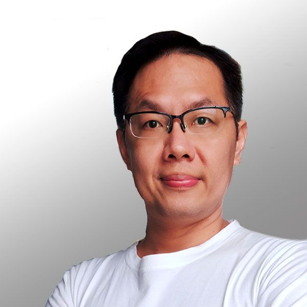 Abraham Anak Agung is a man with warm smile and cool glasses.