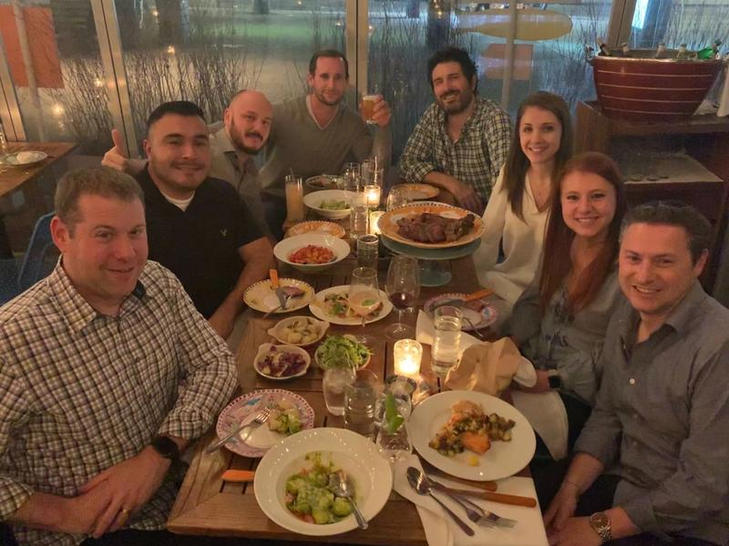 Colleagues dining around in New York.