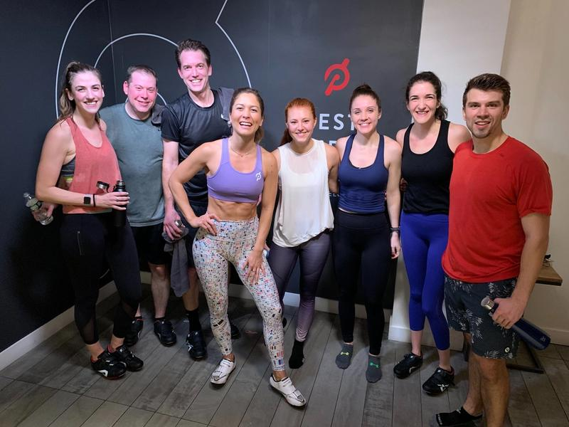 Group of colleagues at a Peloton workout class.