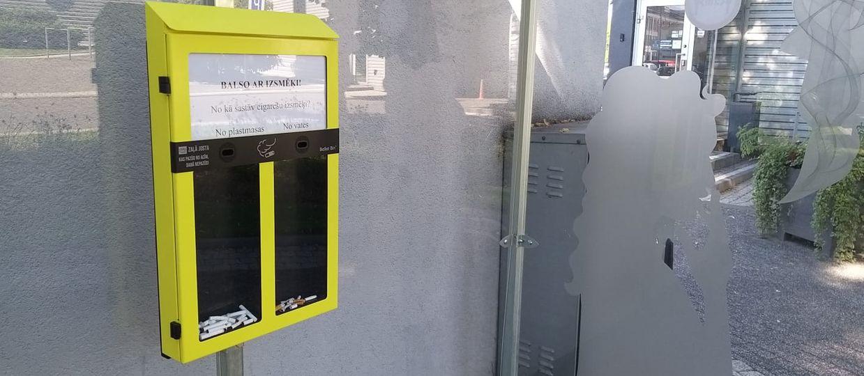 Cover Image for Uzstādītas unikālas cigarešu izsmēķu savākšanas / balsošanas tvertnes, mudinot smēķētājus nemest izsmēķus nepiemērotās vietās