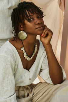 Young black woman staring into camera pensive