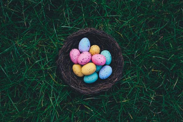 A basket of multicolored Easter eggs