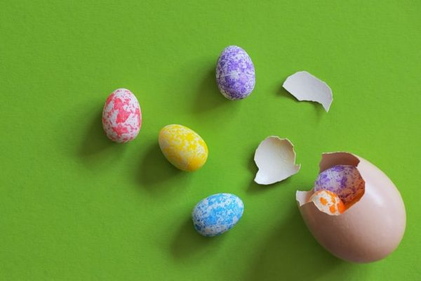 Colorful Easter eggs on a bright green surface