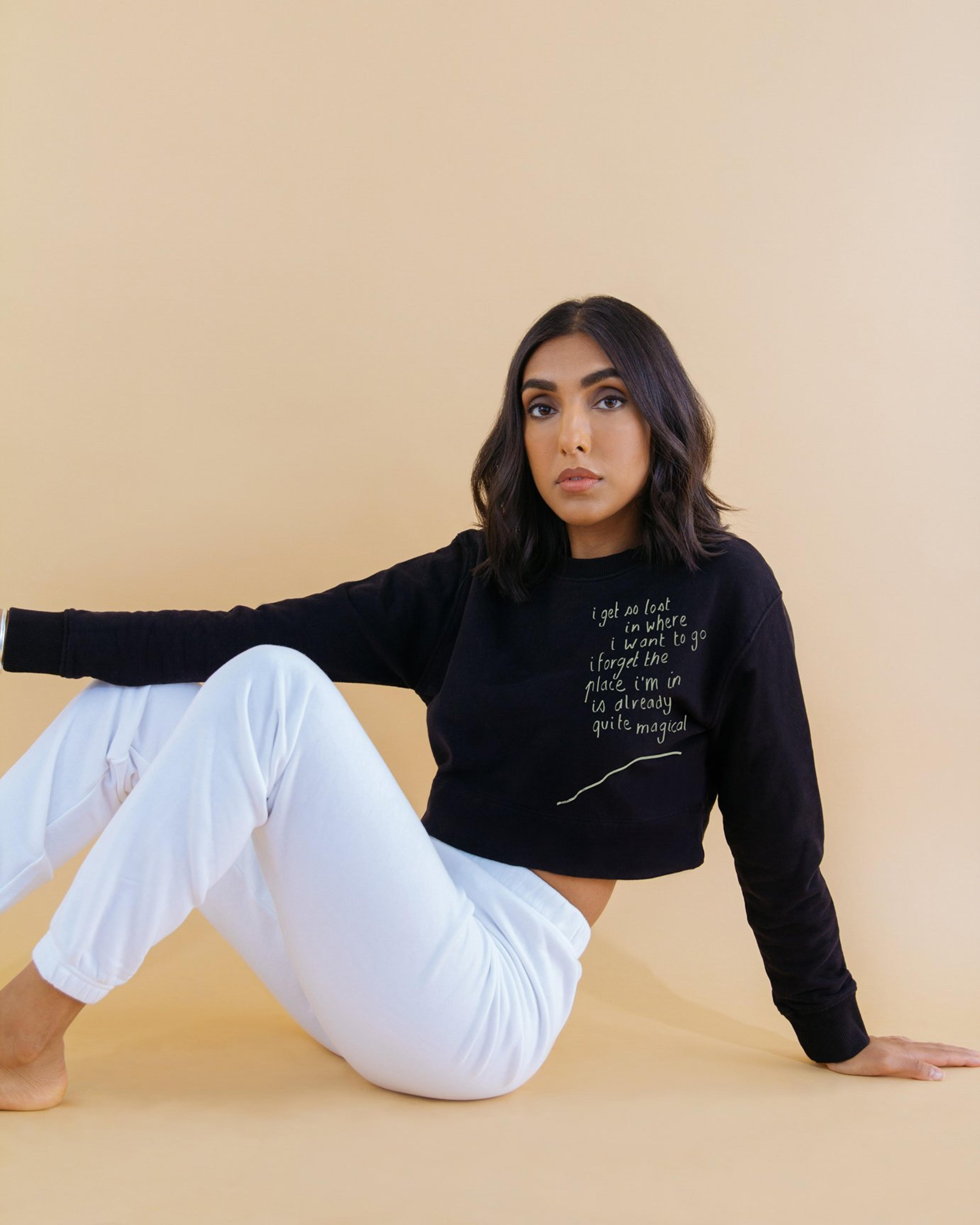 A Sweatshirt designed by Rupi Kaur, made by Kotn Supply