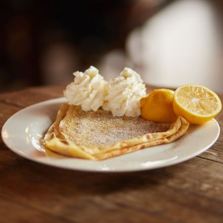 A lemon crepe garnished with whipped crème