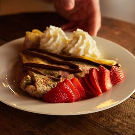 A Nutella crepe garnished with whipped crème