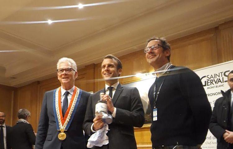 Emmanuel Macron - accepting a bottle of Le Gin du Mont Blanc