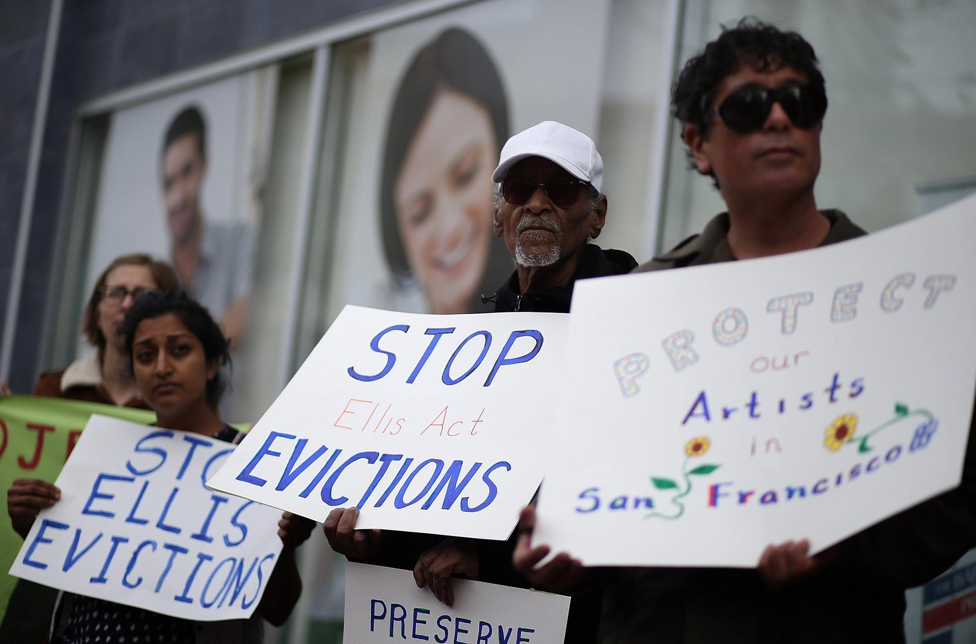 Tenants of 1049 Market Street in San Francisco, including artists, protest against the landlord's attempts to evict them from the rent-controlled building in 2016 Photo by Justin Sullivan/Getty Images