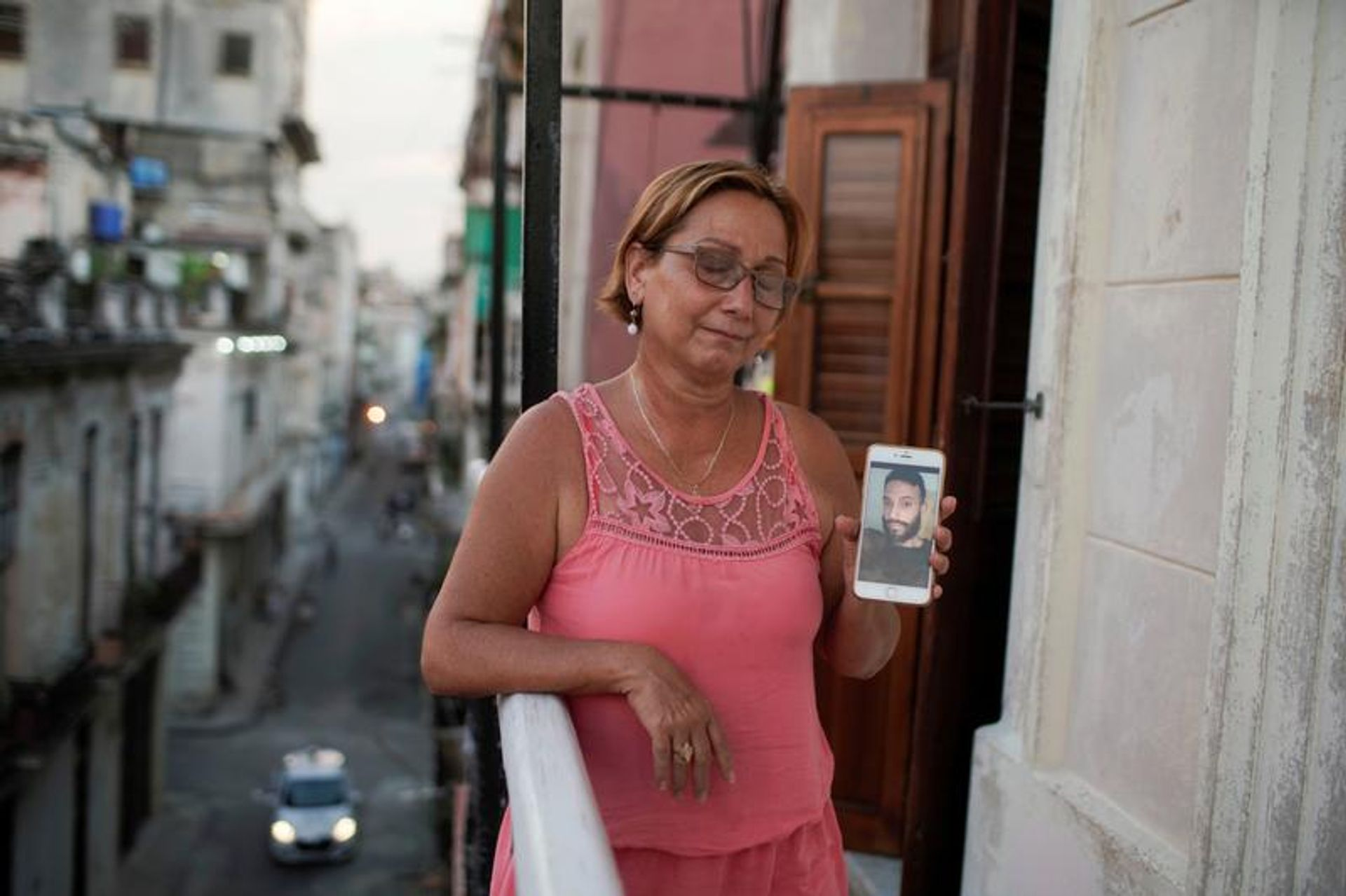 Raisa Gonzalez shows a picture of her son Anyelo Troya Gonzalez, an artist arrested after protests in Havana REUTERS/Alexandre Meneghini