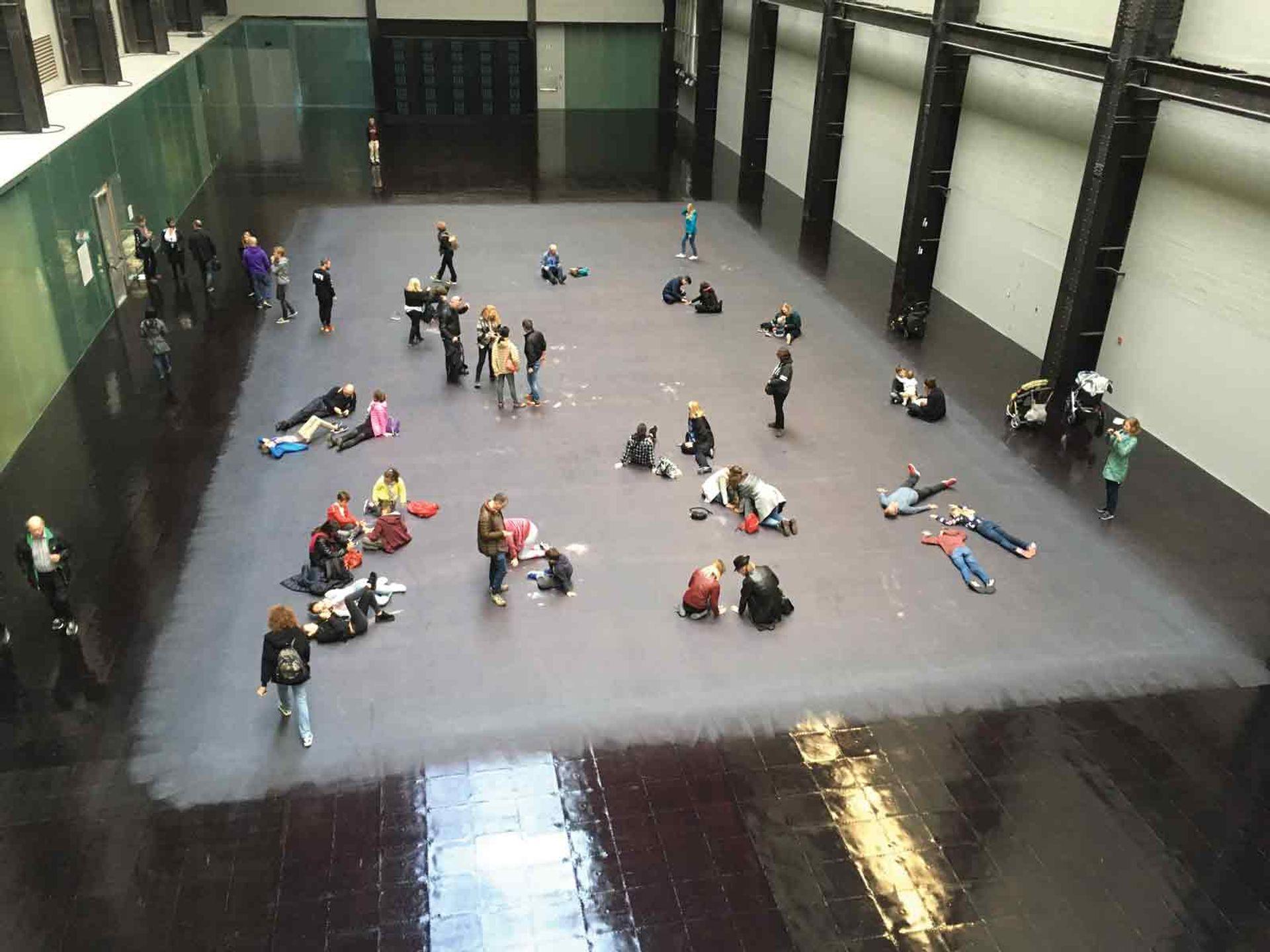 The paint on the Turbine Hall's floor changes colour with body heat José da Silva