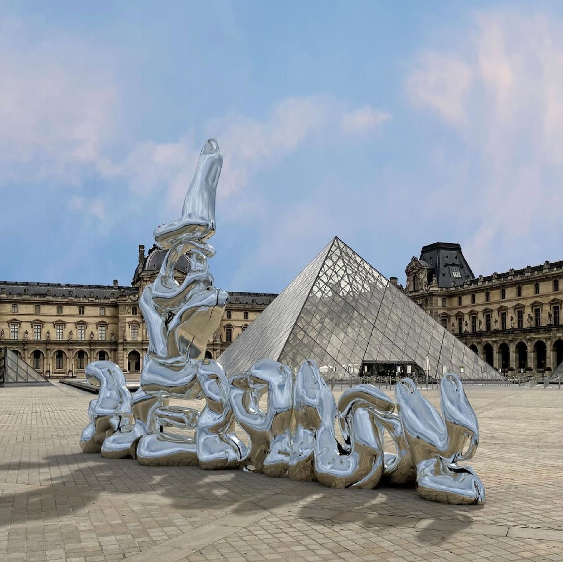 Andy Picci's digital work Love Yourself, visible by using a smartphone near the Louvre pyramid in Paris, is part of CADAF's Digital Art Month Image: Andy Picci
