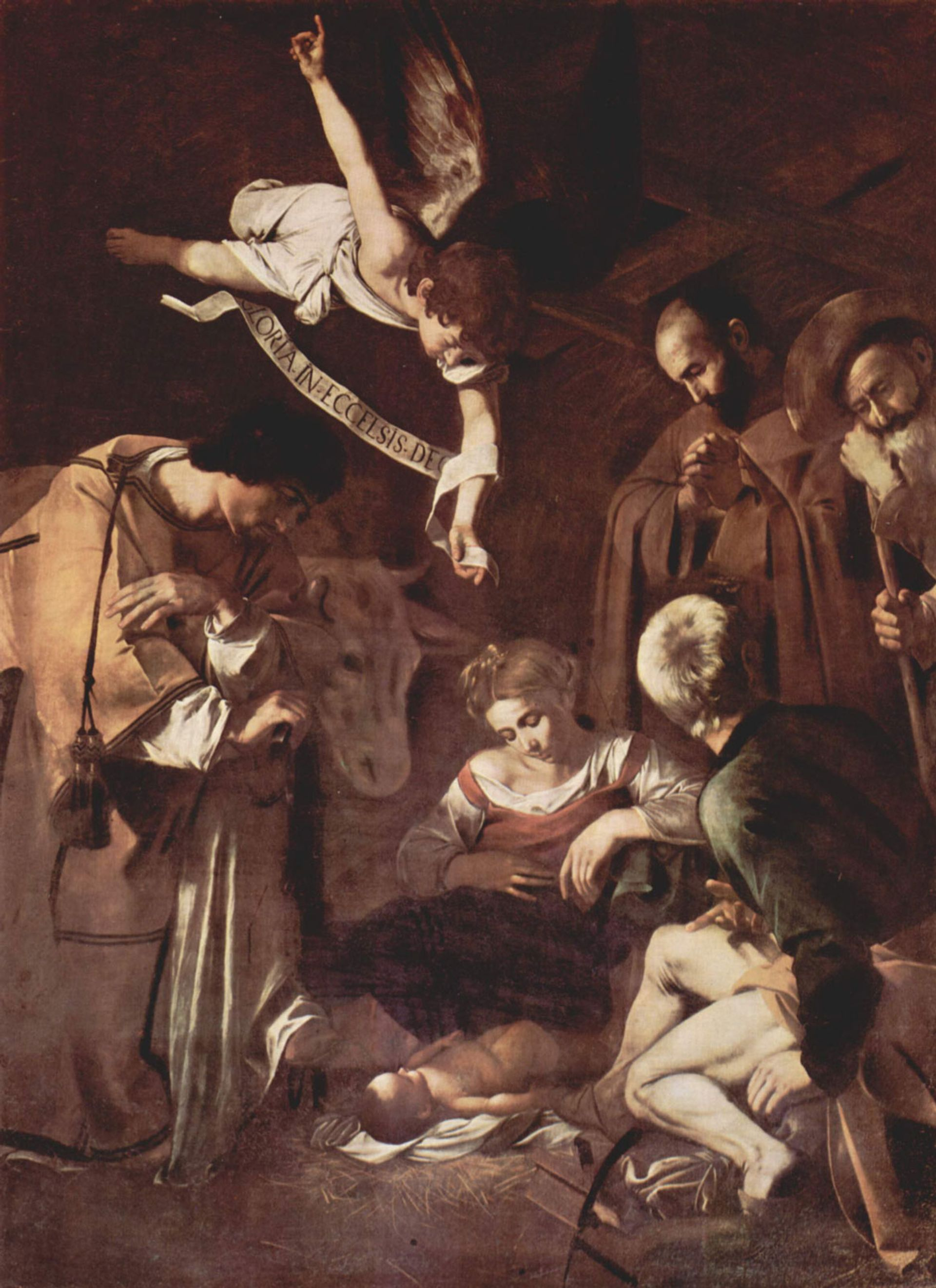 Caravaggio, Nativity with St. Francis and St. Lawrence (1600) Wikimedia Commons