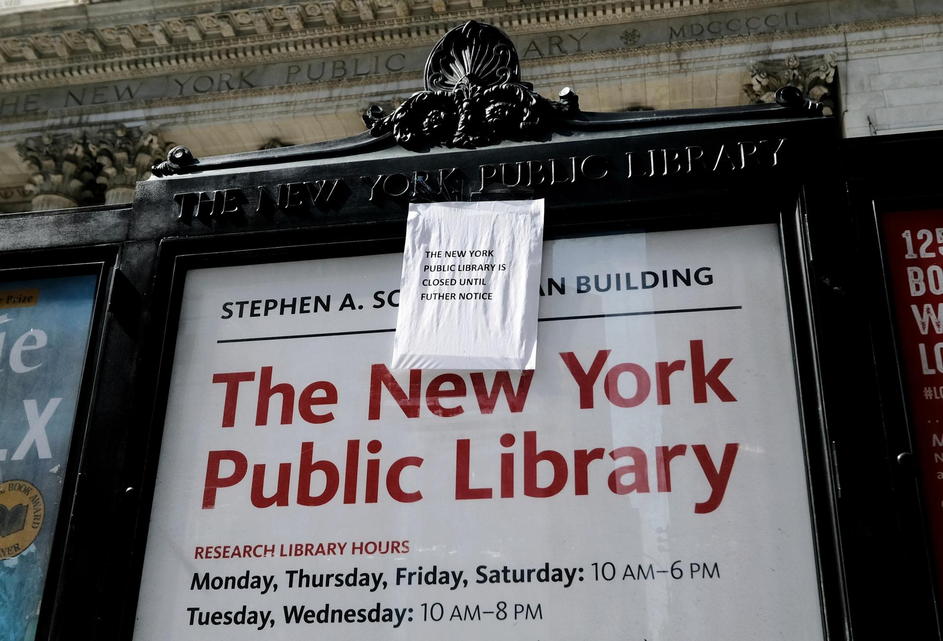 A sign posted outside The New York Public Library announces that the library is closed until further notice Photo by Evan Agostini/Invision/AP