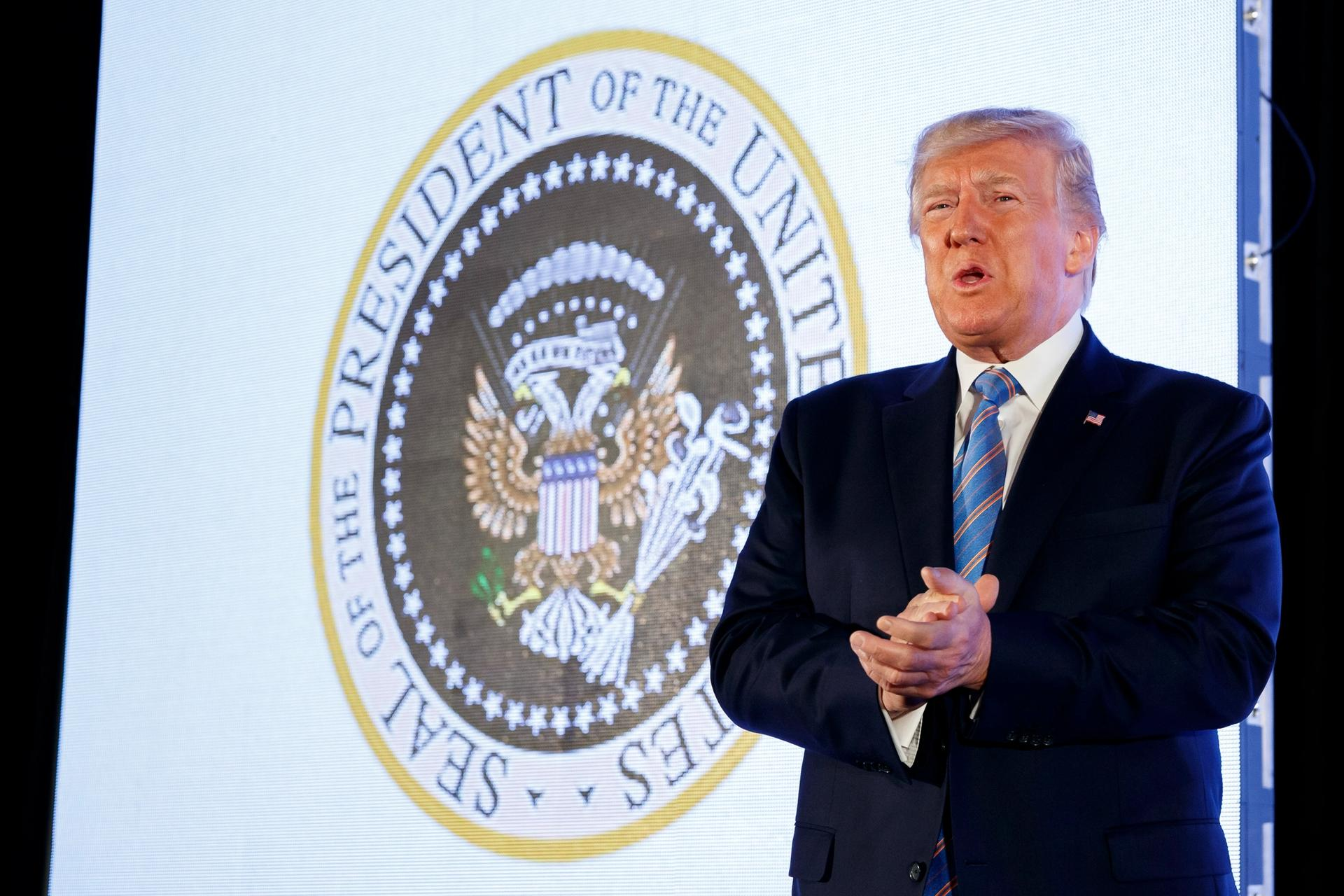 President Donald Trump arrives to speak, with an altered presidential seal behind him, at Turning Point USA's Teen Student Action Summit 2019 AP Photo/Alex Brandon