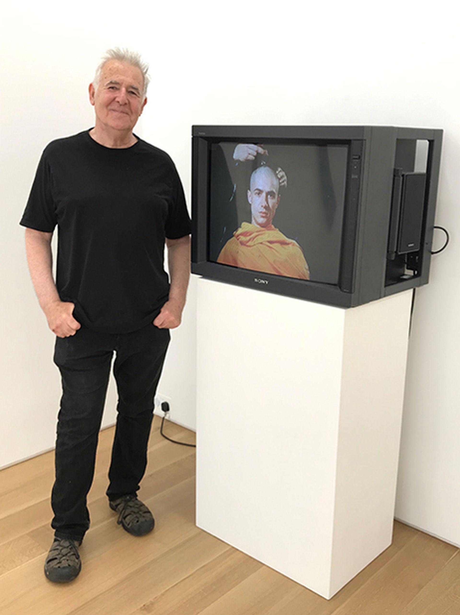 John Smith with his work Om (1986) Courtesy of Marlborough gallery