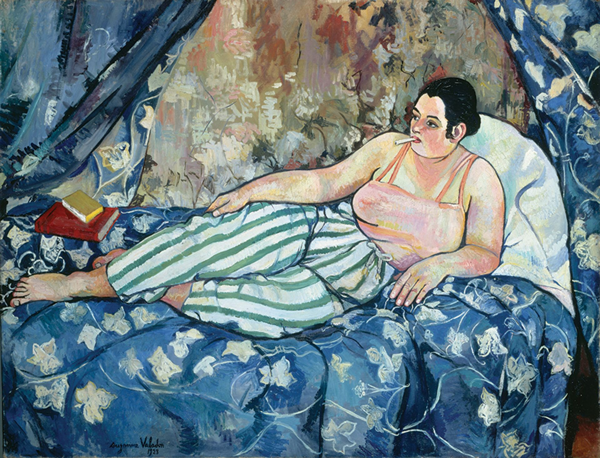 In The Blue Room (1923), Valadon replaces the traditional female nudewith a woman wearing stripey trousers, a cigarette hanging from her mouth Photo: Jacqueline Hyde; © Collection Centre Pompidou; © 2021 ARS, New York/Image © CNAC/MNAM; Dist. RMN-Grand Palais/Art Resource, NY