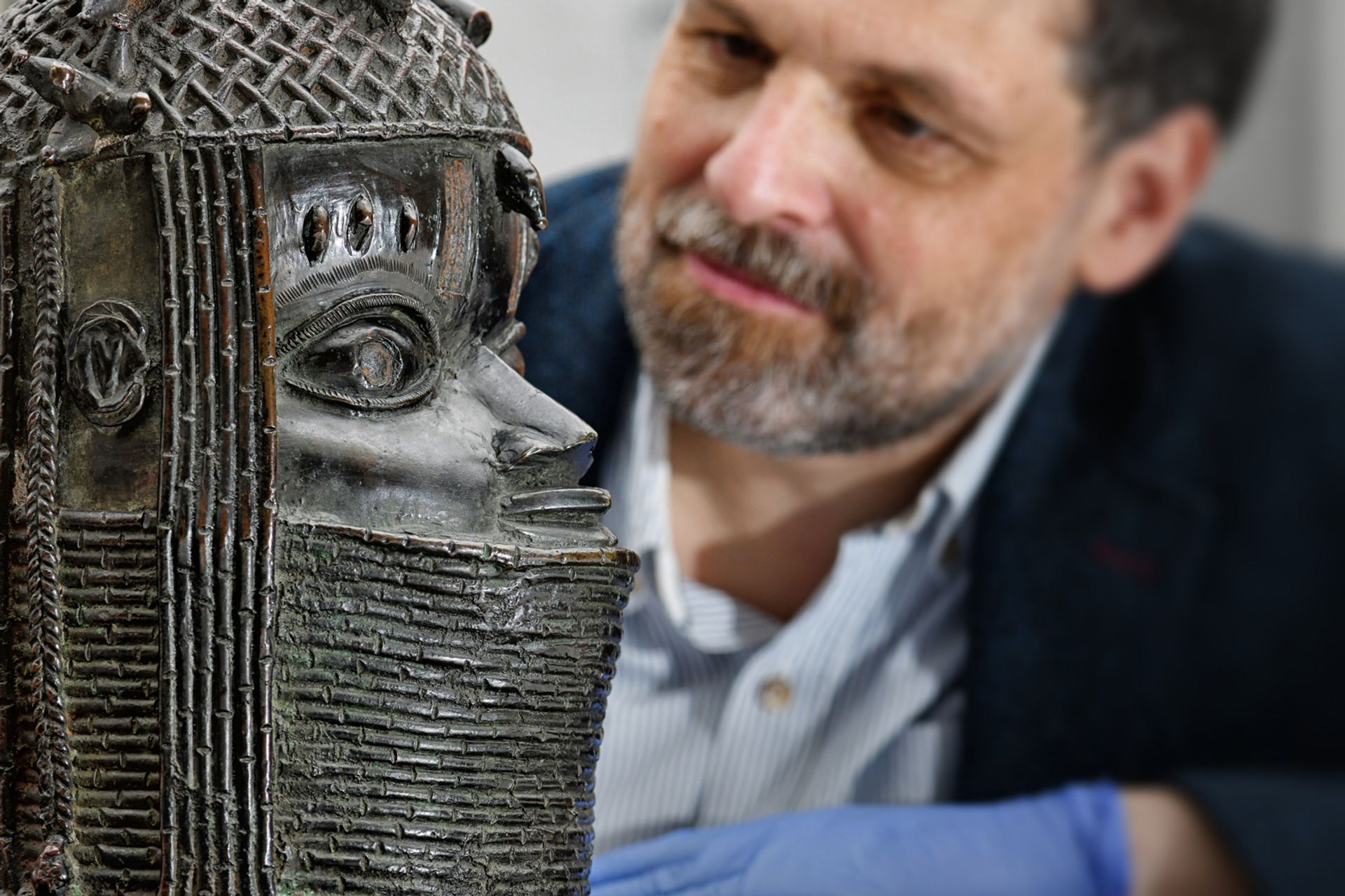 Neil Curtis, the head of museums and special collections at the University of Aberdeen, with the Benin sculpture Image: courtesy of University of Aberdeen