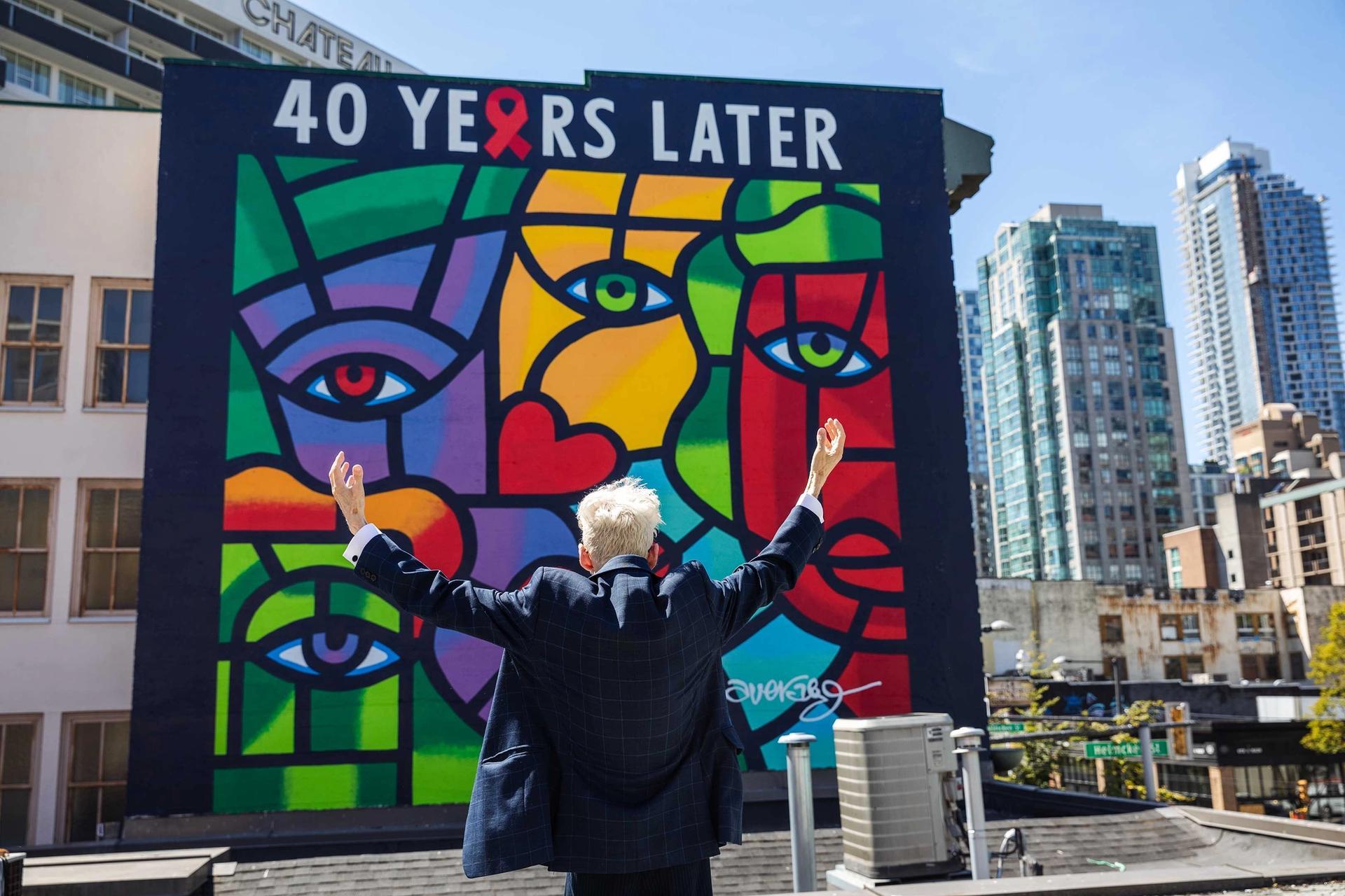 Joe Average in front of his new mural One World, One Hope—40 Years Later Photo: Mavreen David