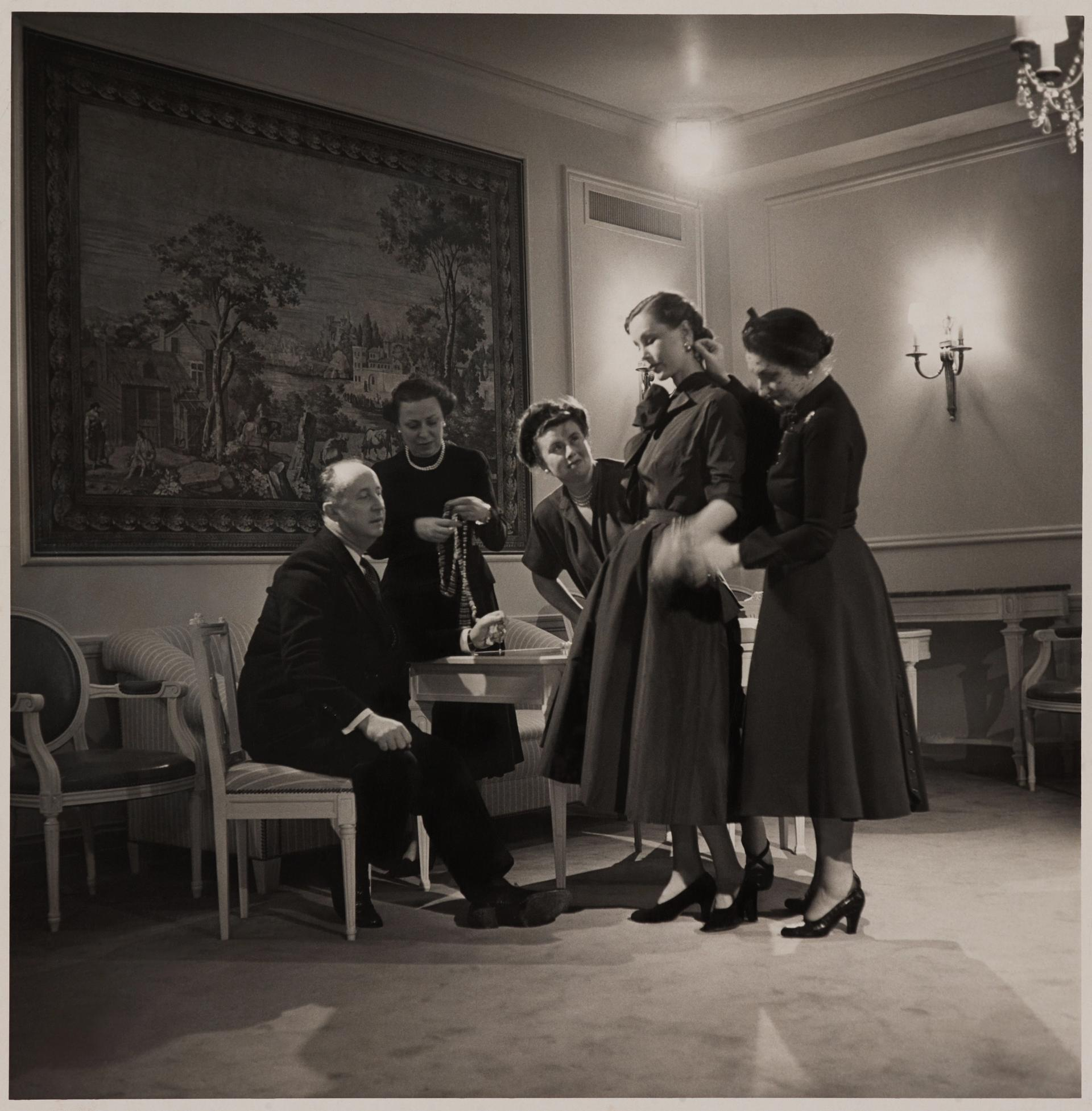 Fitting in a Christian Dior–New York salon with (left to right) Christian Dior, Raymonde Zehnacker, Marguerite Carré, Mrs. Knoll, and Mizza Bricard, 1948 Brooklyn Museum Libraries and Archives. BMA artist files