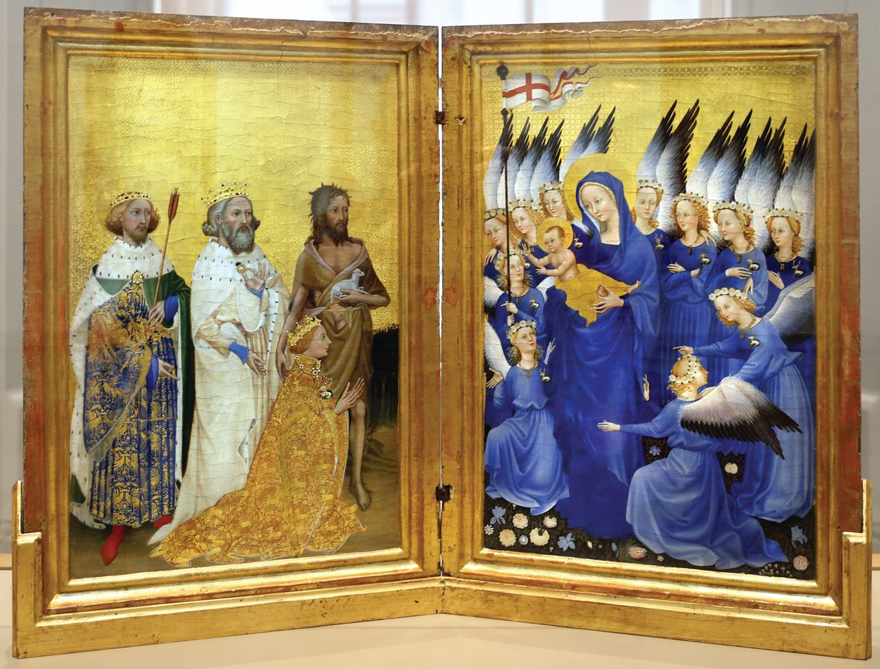 """The tooled gold inner panels of the small portable 14th-century Wilton Diptych  flicker """"like a lantern that has shone through six centuries"""" Courtesy National Gallery, London"""