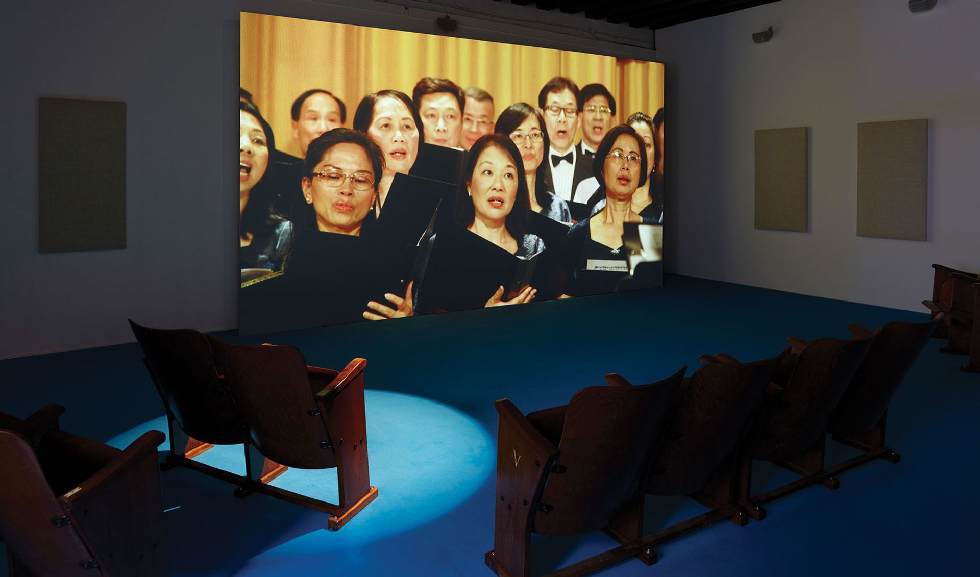 The Hong Kong Federation of Trade Unions Choir perform We are the World in Samson Young's installation Simon Vogel