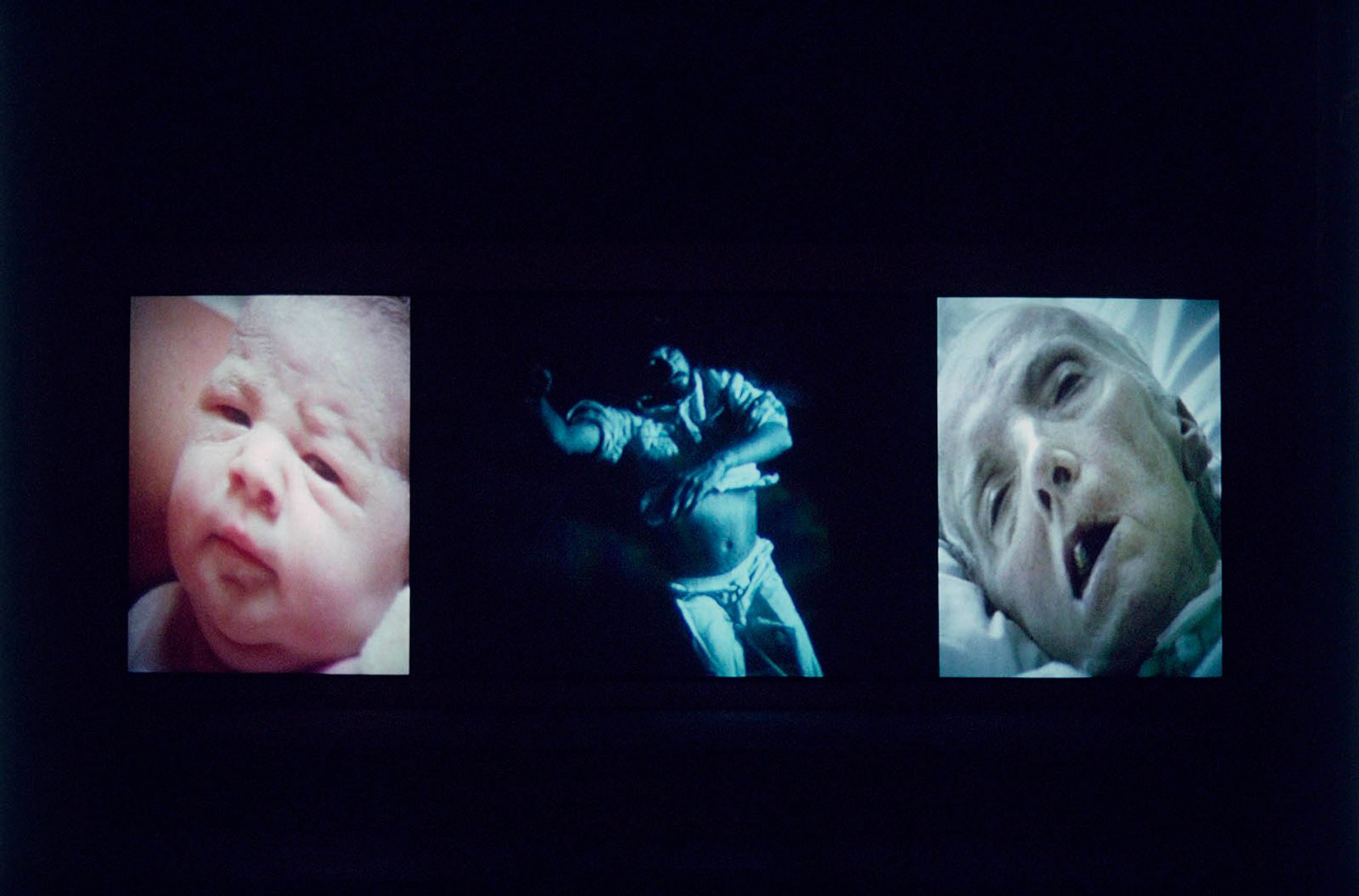 """Bill Viola's Nantes Triptych (1992) includes images of a woman giving birth and the artist's mother on her deathbed. """"It is the awareness of our own mortality that defines the nature of human beings,"""" Viola has said Courtesy Bill Viola Studio Photo: Kira Perov"""