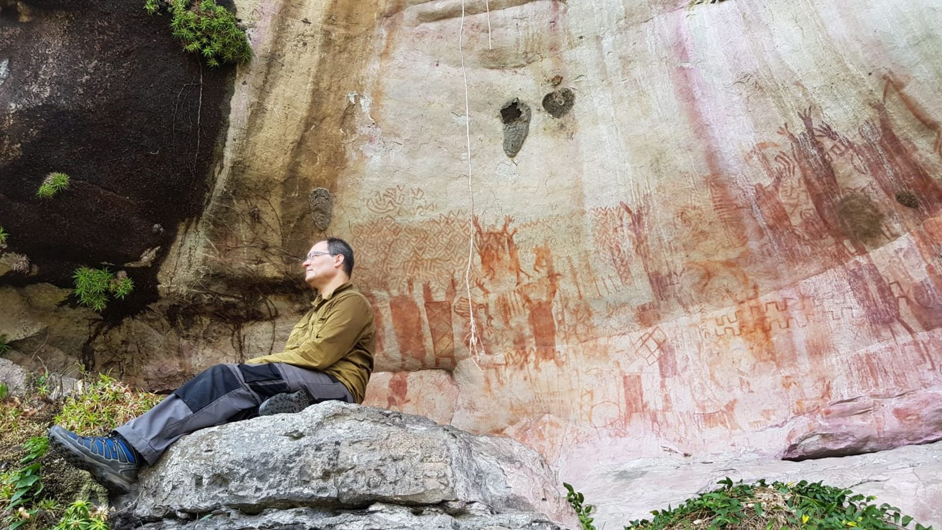 José Iriarte, professor of Archaeology at Exeter, at a rock art wall depicting mastadons in the Amazon rainforest Credit: José Iriarte