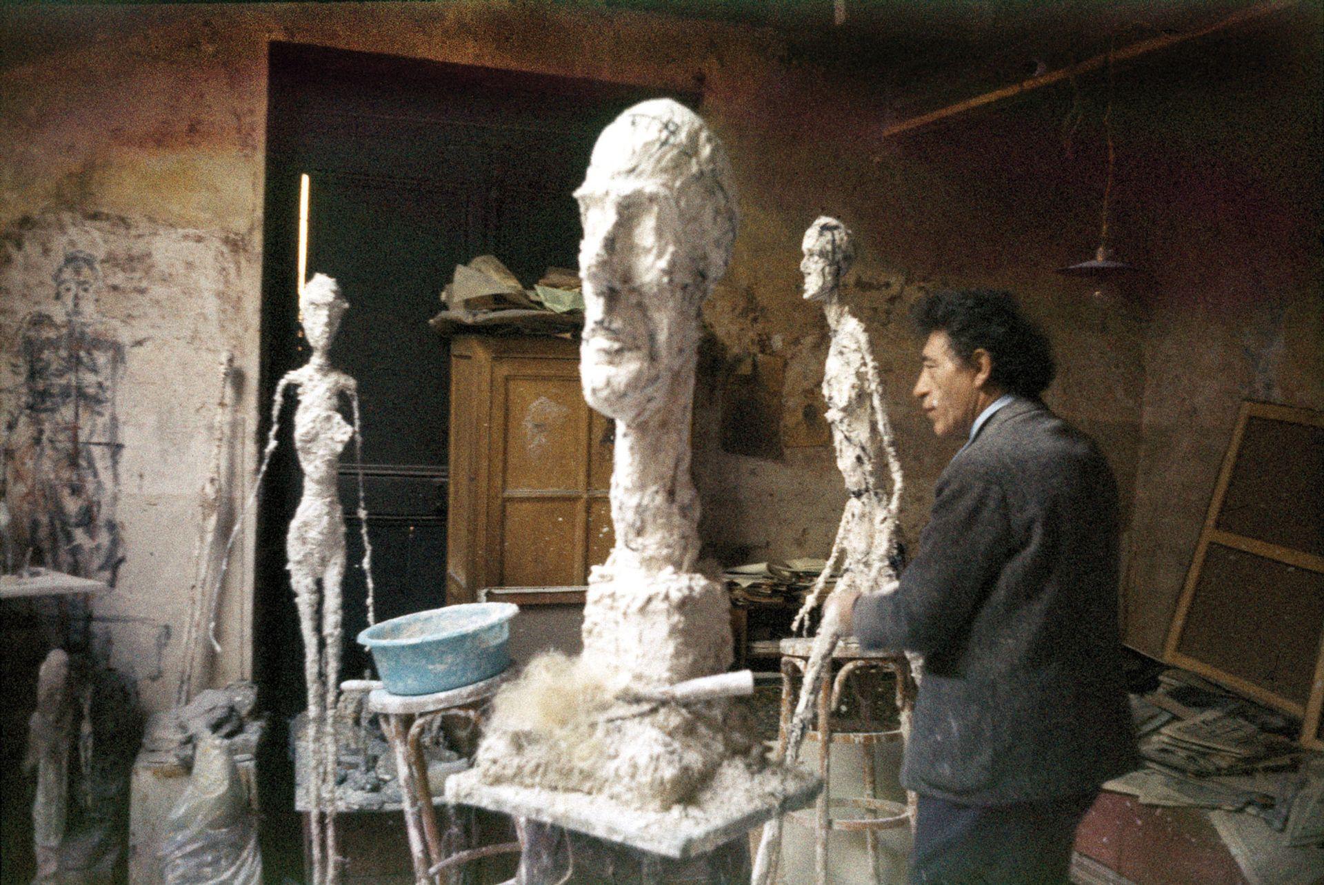 The artist in his studio on Rue Hippolyte-Maindron  around 1960. Ernst Scheidegger/Giacometti Foundation Archives; © Giacometti Estate (Giacometti Foundation + ADAGP)