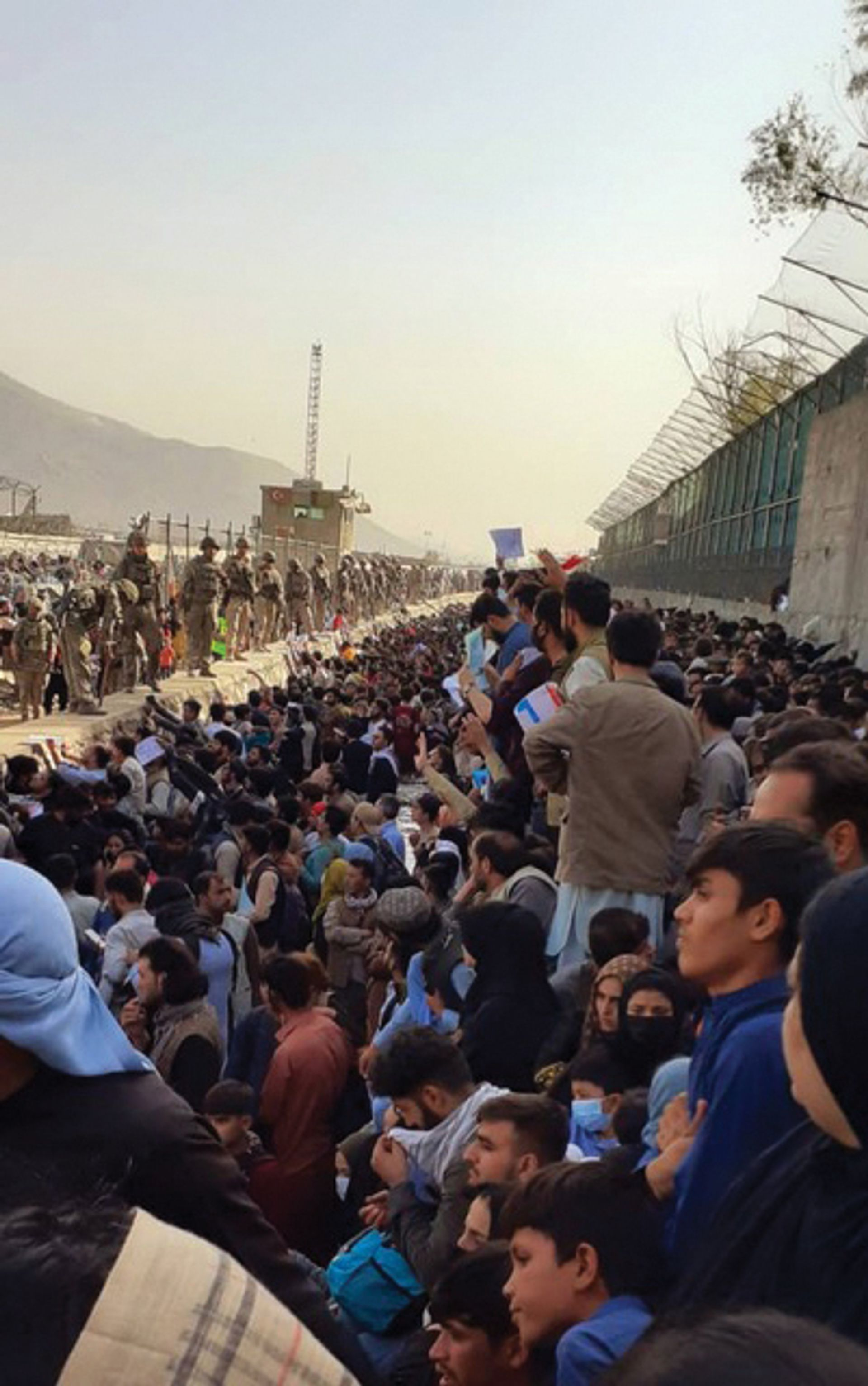 The crowds at Kabul airport's Abbey Gate full of people hoping to board one of the evacuation flights last month
