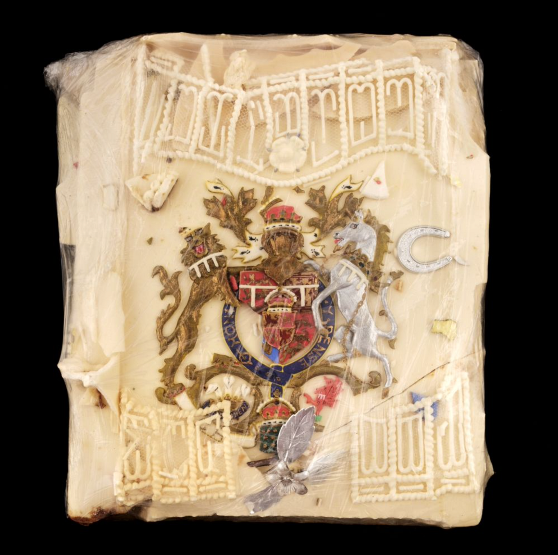 The slice of cake icing with the Royal Coat-of-Arms from the wedding of Prince Charles and Lady Diana Spencer in 1981 Courtesy of Dominic Winter Auctioneers