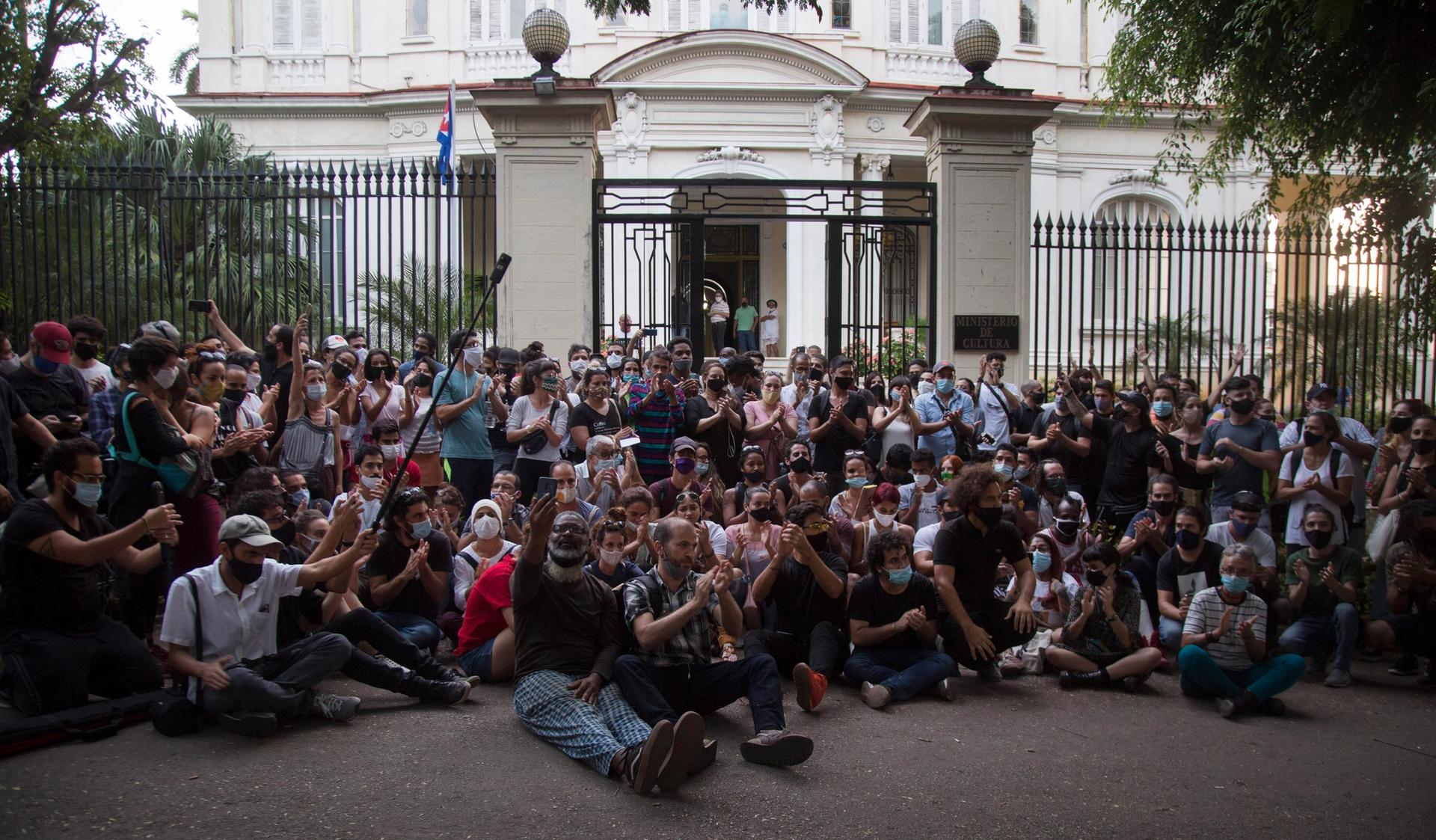 Young artists protest in front of the doors of the Ministry of Culture, in Havana, Cuba, on 27 November AP Photo/Ismael Francisco