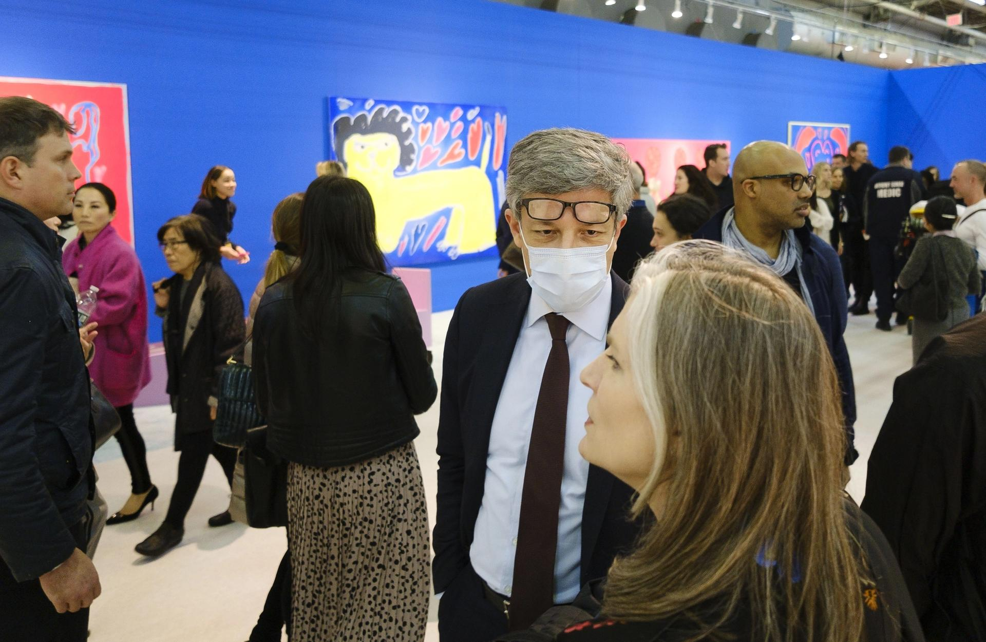 A man wears a protective face mask while visiting at the Armory Show. Justin Lane/EPA-EFE/Shutterstock