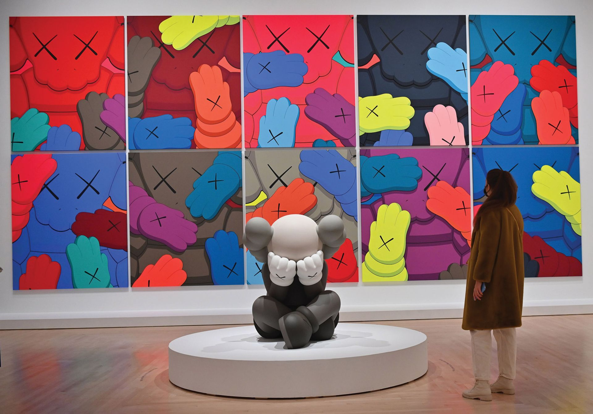 X-offender: a group of prints from KAWS's Urge series, and a sculpture, Separated, in the Brooklyn Museum show Photo by ANGELA WEISS/AFP via Getty Images; works © kaws