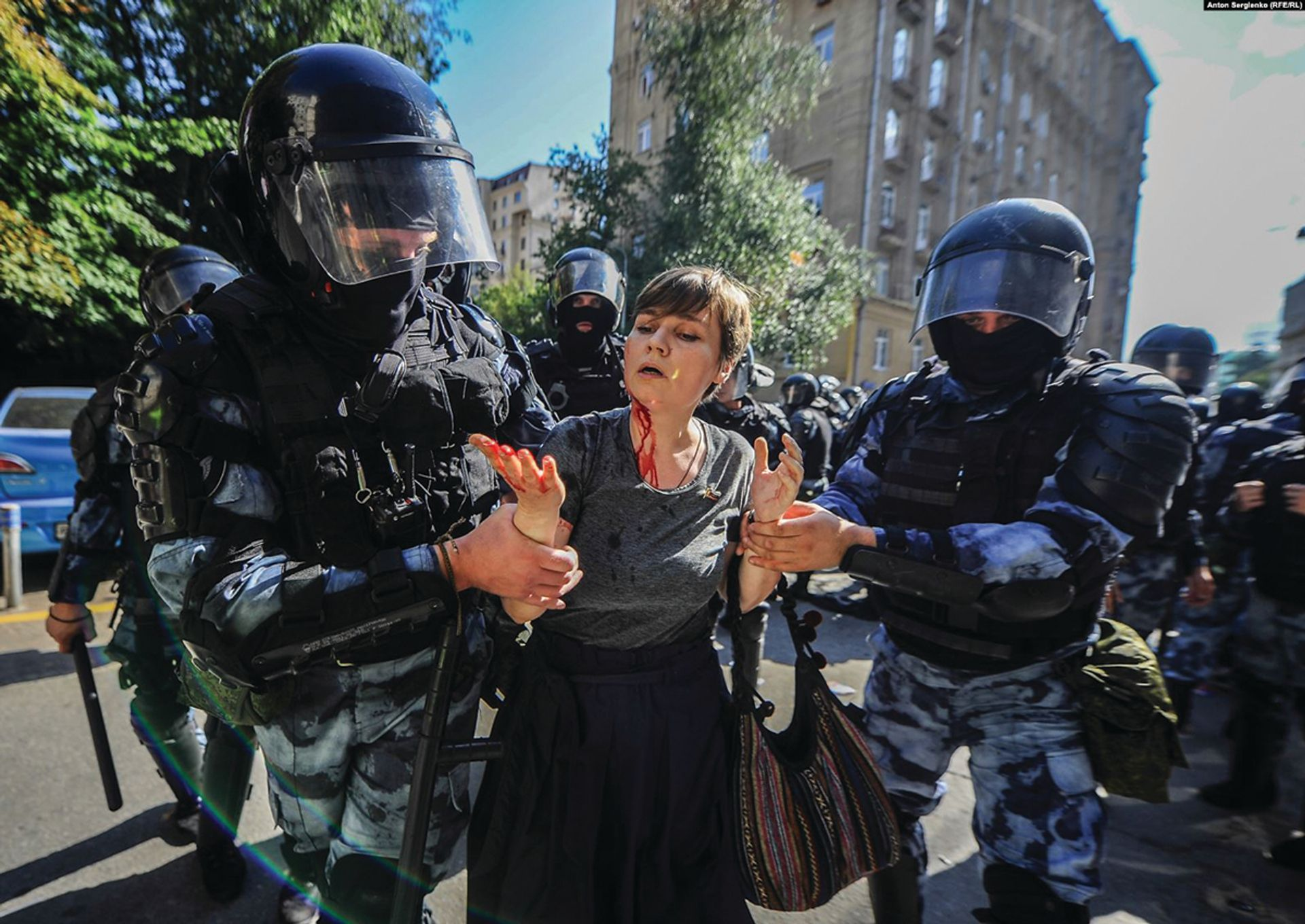 Alexsandra Parushina, an artist and district legislator, is led away from a protest after being beaten by riot police ©Anton Sergienko