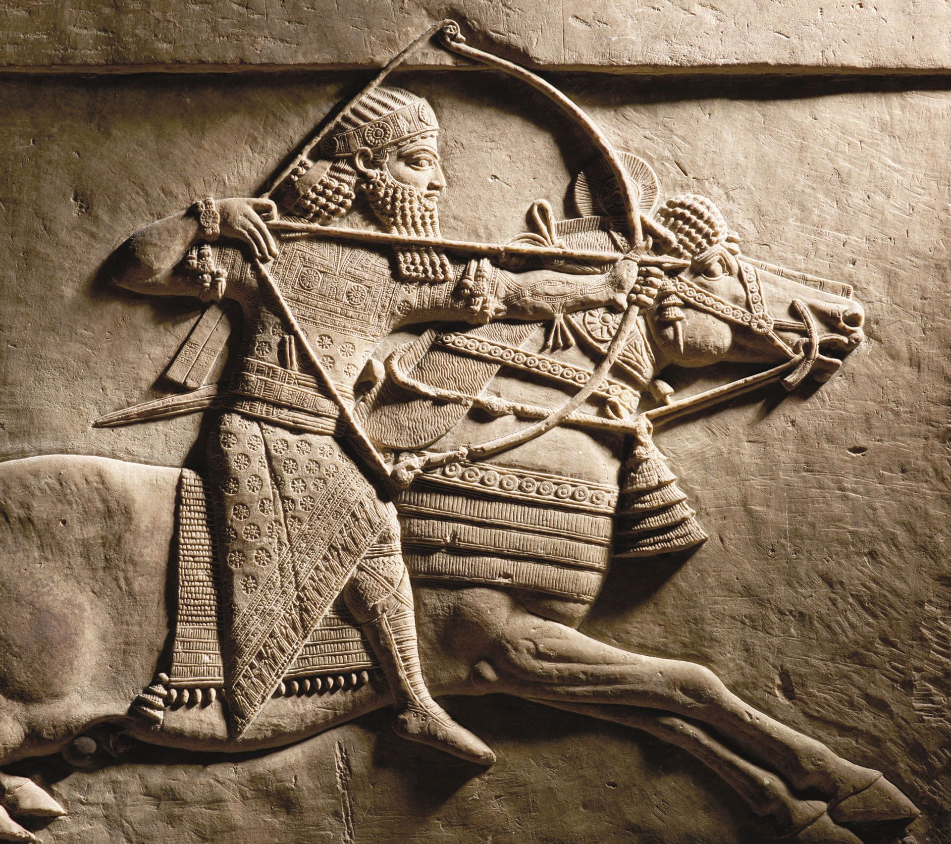 Relief of Ashurbanipal hunting on horseback (detail, 645-635BC) © The Trustees of the British Museum
