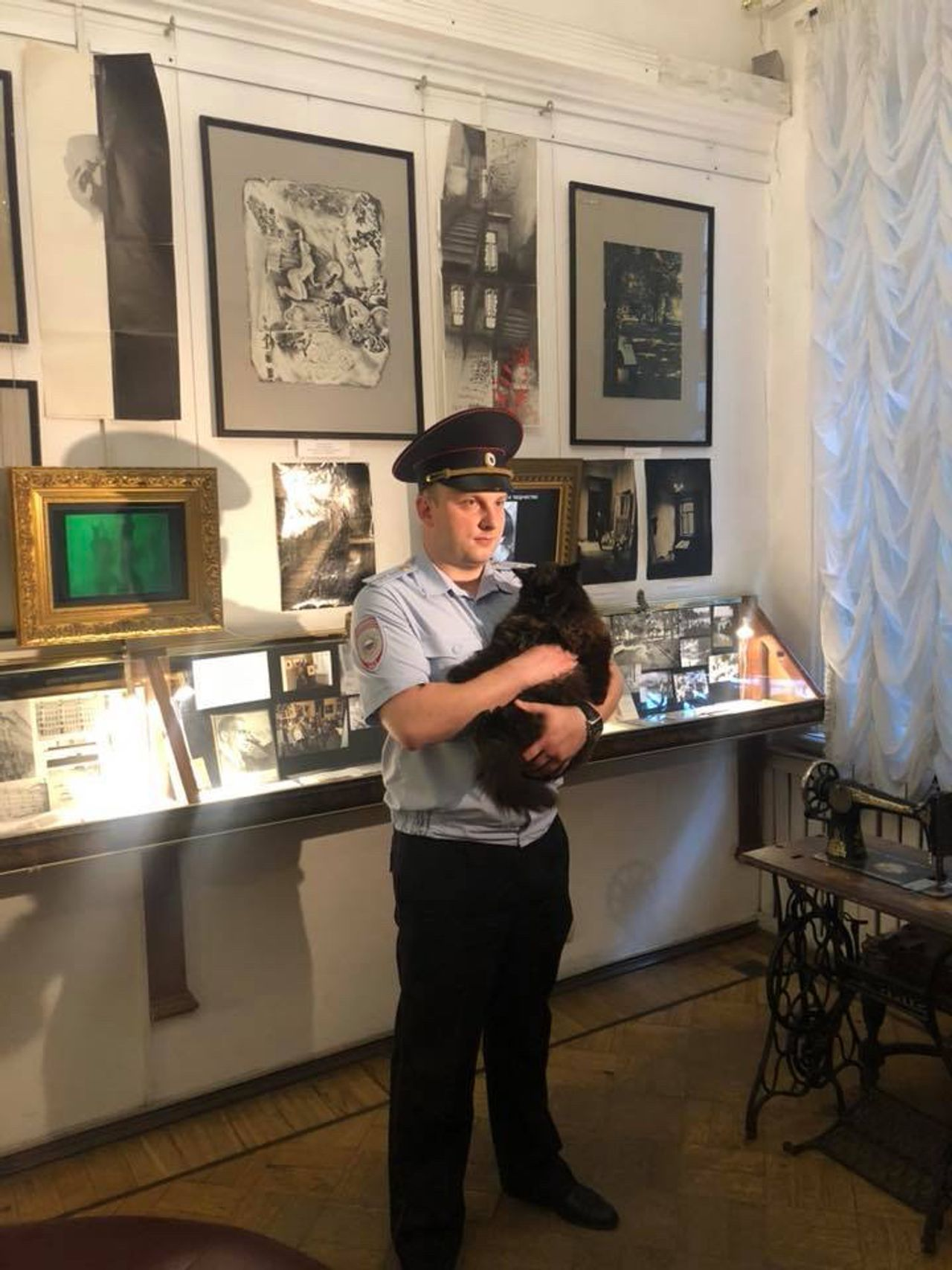 A Russian policeman carries Begemot courtesy Bulgakov Museum