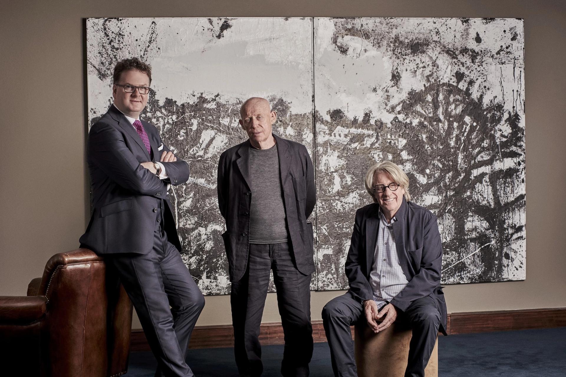 Ewan Venters (left), CEO Fortnum & Mason, John Virtue, and Frank Cohen in front of Virtue's Landscape No. 174 courtesy Frank Cohen