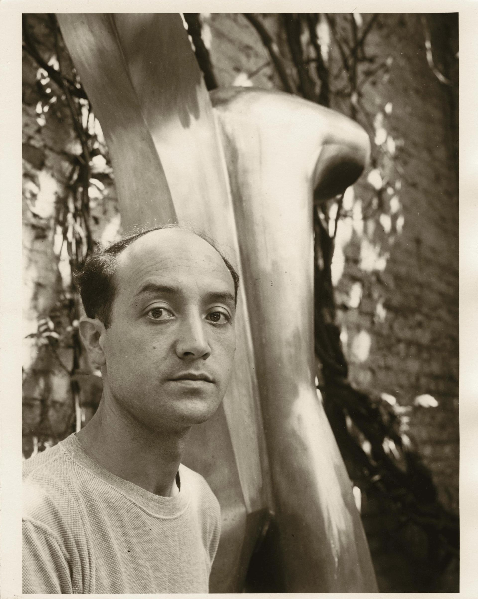 Isamu Noguchi in the courtyard of his MacDougal alley studio with Man Aviator (1943-49) © The Isamu Noguchi Foundation and Garden Museum, New York/ARS. Photo by Gina Hohensee