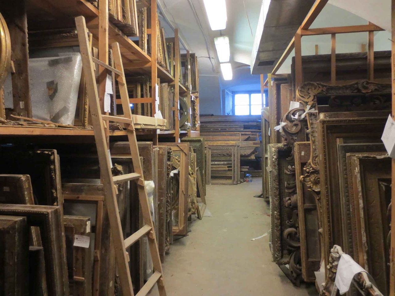 """Thousands of antique frames are stored in the basement of the State Russian Museum in St Petersburg, but are officially classified as near-worthless """"supplies"""" rather than museum objects"""