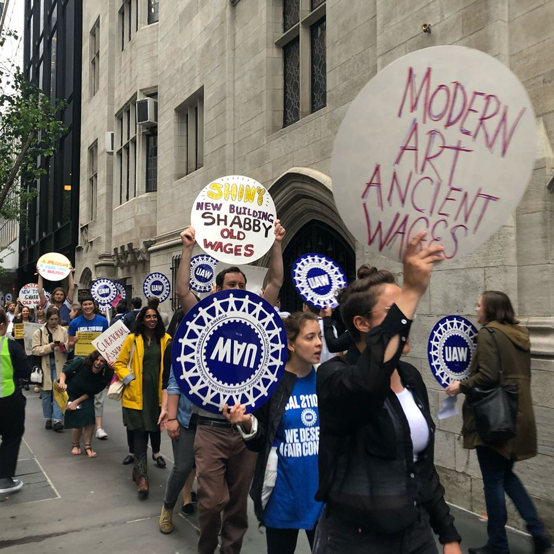 Workers demonstrating outside the Museum of Modern Art last year © @momalocal2110 via Instagram